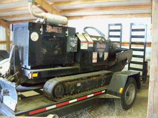 Bandit Tracked Stump Grinder With Remote Controls And Trailer. photo