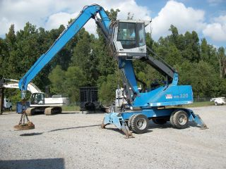 Terex Fuch Mhl - 320 photo