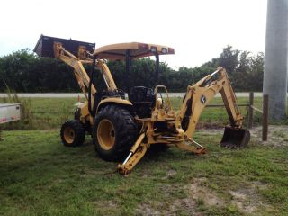 2004 John Deere 110 4x4 Loader Backhoe photo