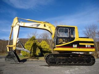 1995 Caterpillar 311 Hydraulic Excavator Trackhoe,  Adjustable Fold Away Thumb photo