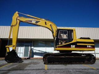 Caterpillar 315l Cat Excavator Trackhoe,  Machine photo