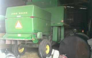 John Deere 7700 Combine W/ Heads photo