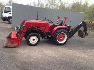 2006 Loader/ Backhoe Tractor - 4 Wheel Drive photo