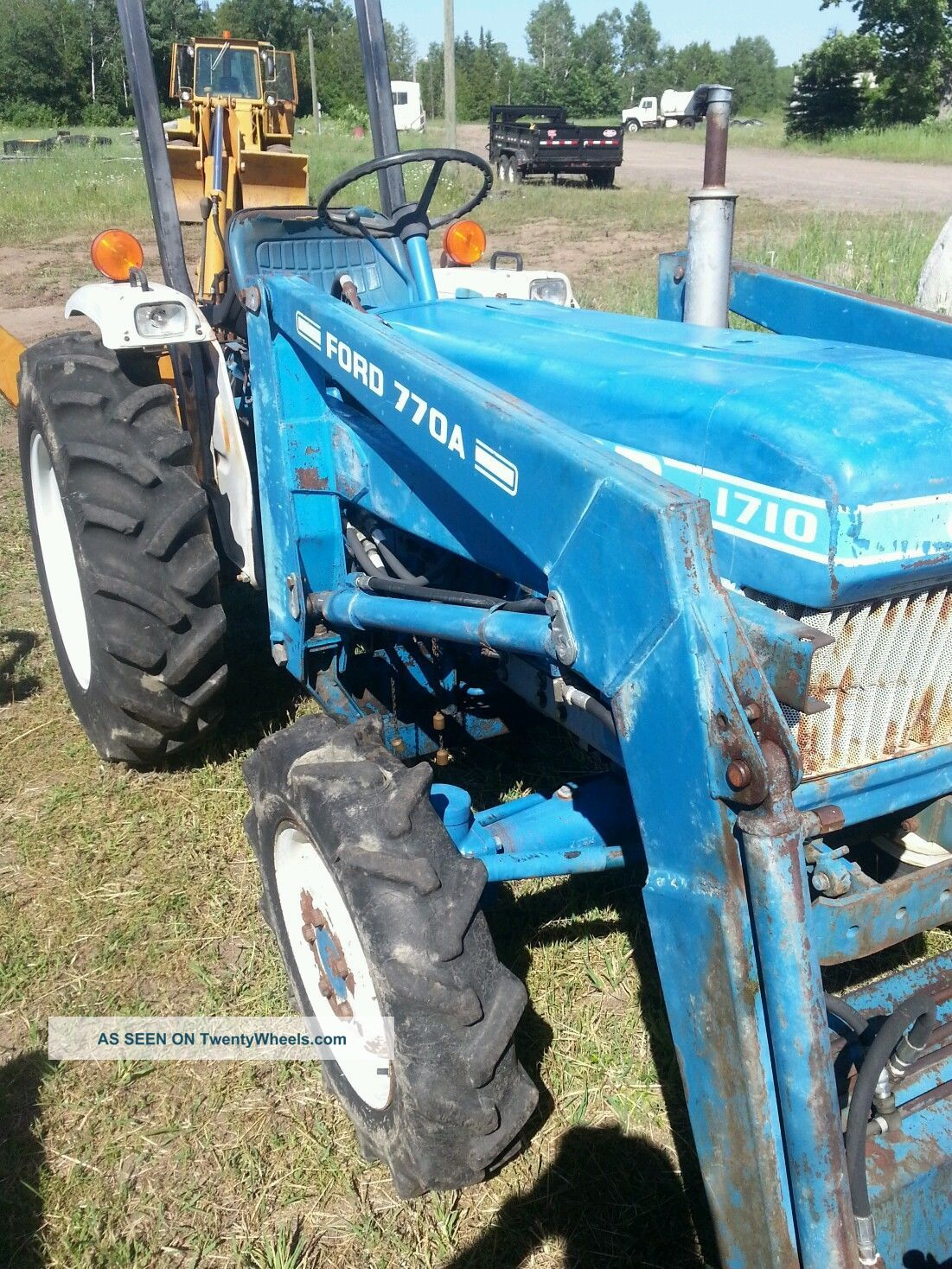 Ford 1710 Loader : Ford tractor with woods backhoe
