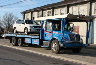 2002 International 4400 Flatbed Tow Truck 4 Car Hauler photo