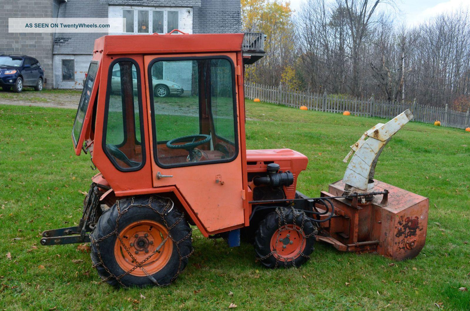 Kubota B7100 Backhoe : Kubota b wd tractor with cab snowblower