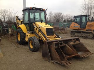 2006 Holland B95 Backhoe - 4 Buckets photo