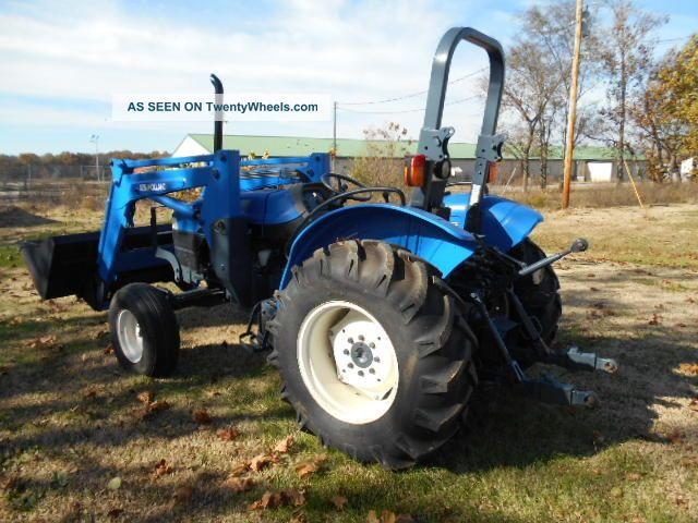 holland tn55 diesel farm tractor with self leveling holland 32la loader. Black Bedroom Furniture Sets. Home Design Ideas