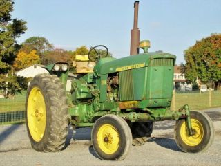 John Deere 3010,  Gas,  Synchro Shift,  Rear Remotes,  Runs Good,  Ready To Go photo