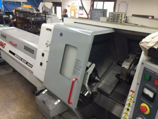 Haas Tl - 15 Cnc Turning Center W/ Sub Spindle Servo 300 Bar Feed Parts Catcher 01 photo