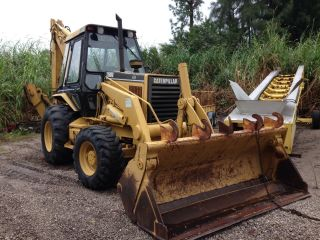 2003 Caterpillar 446b 4wd Inclosed Cab photo
