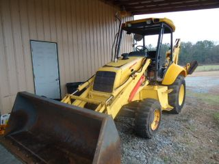 2003 Holland Lb110 4x4 Loader Backhoe photo