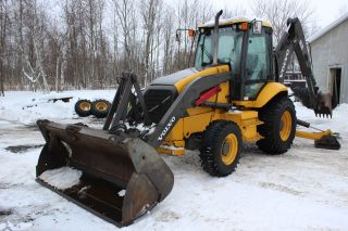 Backhoe Loader Volvo Bl - 70 photo