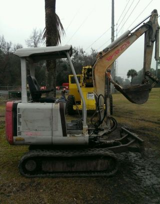 Takeuchi Mini Excavator Model Tb 020 photo