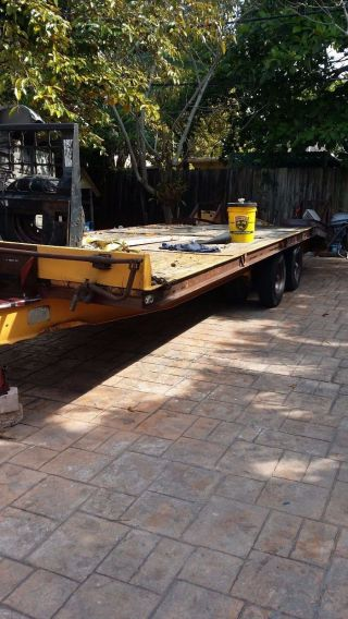 Bobcat And Backhoe Flatbet Trailer 23 ' photo