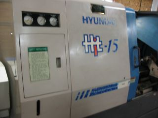 Hyundai Hit15 Cnc Lathe With Bar Feeder photo
