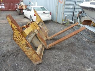 Forks Caterpillar Wheel Loader Quick Disconnect. photo