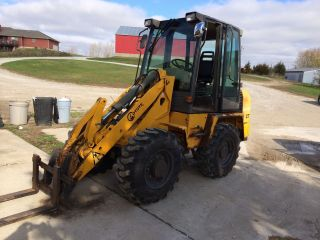 2002 Coyote C7 Compact Loader / Integrated Tool Carrier photo
