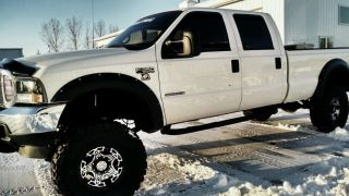 Lifted 2001 White Ford 350 photo