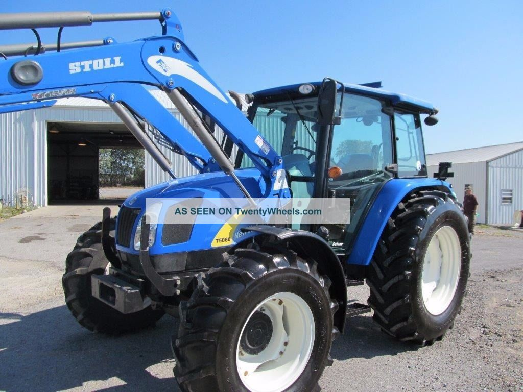 holland t5060 diesel farm tractor 4x4 with loader and cab. Black Bedroom Furniture Sets. Home Design Ideas