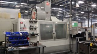 Haas Vf - 6/50 Cnc Vertical Machining Center W/ Hrt - 310 Rotary Table Auger photo