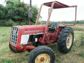 International 464 Gas Utility Tractor,  With Rough 5 Foot J.  D.  Rotary Cutter photo