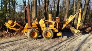 Case Dh4b Trencher Deisel Backhoe,  6 - Way Blade,  Vibe Plow,  Articulating Steer,  4x4 photo