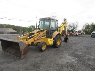 Holland 655e Tractor Loader Backhoe photo