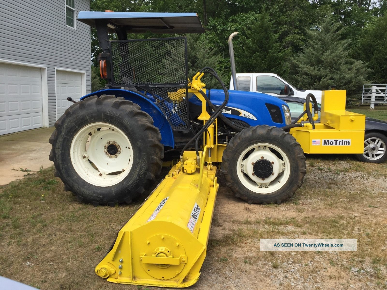 Side Picture Of Tractor : Holland tn a tractor with motrim side mowers
