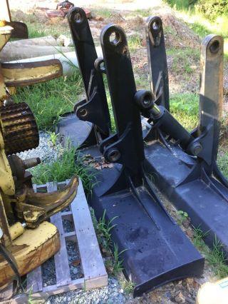 John Deere 85c,  130g,  135c,  135d,  135g Knock Down Blade photo