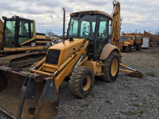 Holland 575e Backhoe Loader With Bucket And Forks photo