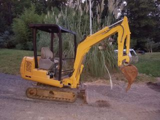 Mini Excavator _ Rubber Tracks _ Good Running Condition _ photo