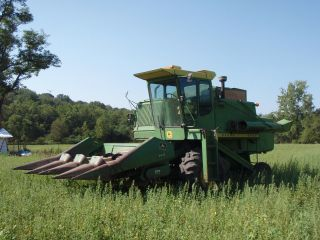 John Deere 6600 Diesel Combine With Corn And Grain Head photo
