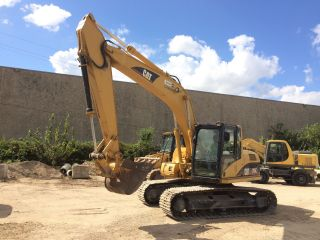 2005 Caterpillar Cat 315cl Excavator; Tx Machine; 4676 Hrs photo