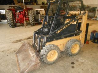 Holland L - 255 Diesel Skidloader Low Hrs One Owner Tires Have Manuels photo