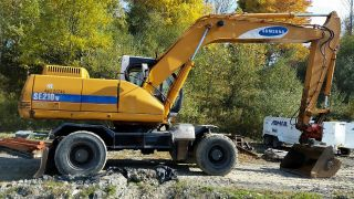 1994 Samsung Se210w Wheeled Excavator With Standard Blade. photo