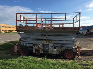 Skyjack 5094 4wd Scissor Lift 50 ' Deck Hgt,  56 ' Work Hgt,  With Outriggers photo