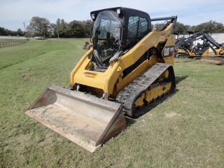 13 ' Caterpillar 299d Skid Steer photo