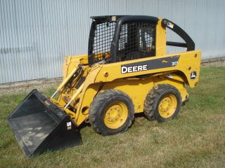 John Deere 317 Skidsteer Diesel Very photo