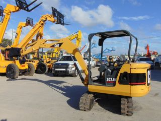 2006 Cat 302.  5 Min Excavator - 2 Speed W/ Blade - Tracks - photo