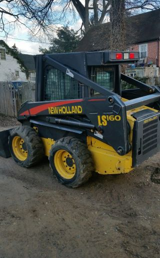 2003 Holland Ls 160 Skid Loader Enclosed Cab photo