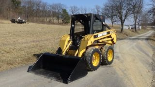 John Deere 5575 Skid Steer With Bucket photo