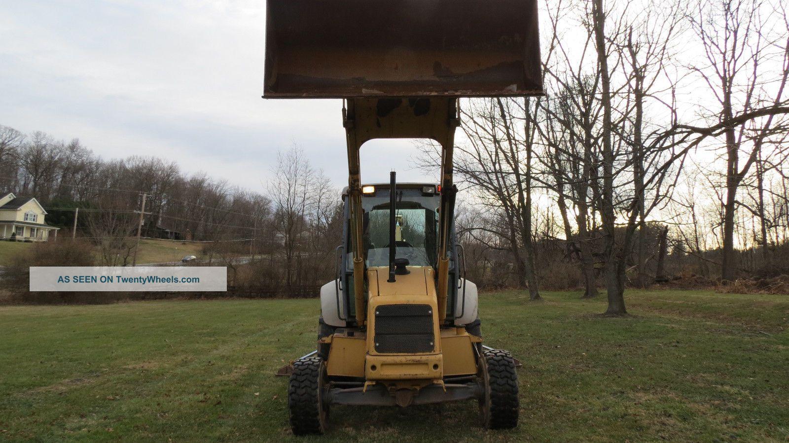 1997 Holland 555e 4x4 Tractor Loader Backhoe Cab W/ Heat 83hp Diesel Backhoe Loaders photo