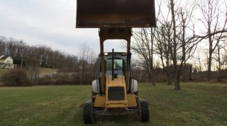 1997 Holland 555e 4x4 Tractor Loader Backhoe Cab W/ Heat 83hp Diesel photo