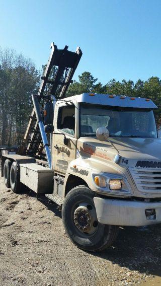 2005 Hino 338 Single Axle Roll Off Truck photo