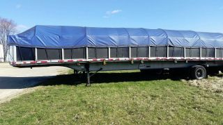 2003 48ft East Flatbed Trailer With Sidekit photo