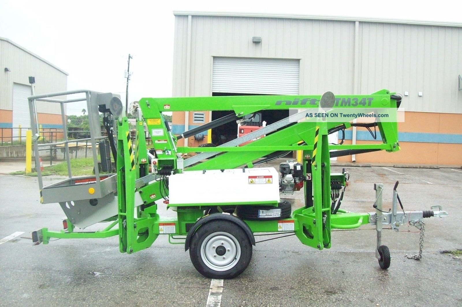 Nifty Tm34t 40 ' Boom Lift,  Hydraulic Outriggers,  20 ' Outreach,  Battery Powered,  Insc Scissor & Boom Lifts photo