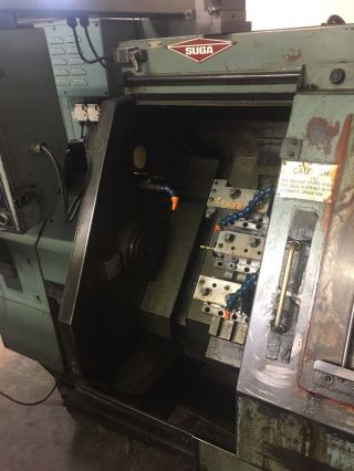 Suga St - 100 Slant Bed Gang Tool Cnc Lathe photo