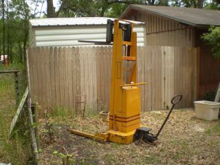 Rol - Lift.  Pallet Stacker.  Forklift.  Capacity 2,  000 Lbs.  Battery Charger.  6 ' Lift. photo