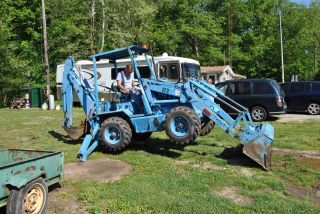 Earth Force 4 Wheel Drive 4 Wheel Steering Backhoe Loader photo